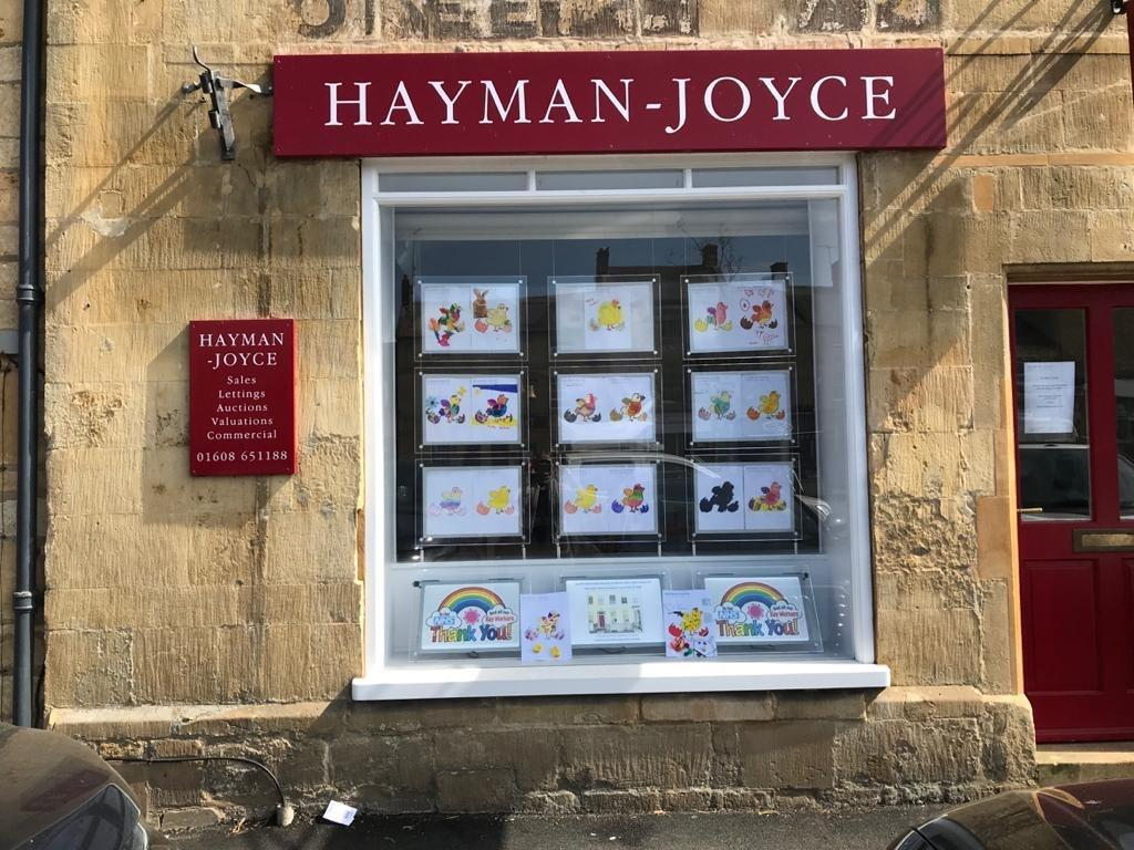 Eggs-citing Easter entries for the Hayman-Joyce annual art competition are showcased on the High Street